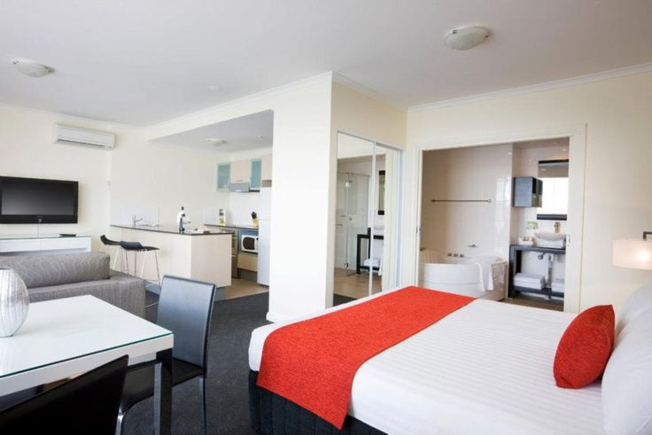 Studio deluxe room with king size bed, large spa bath and fully equipped kitchenette.