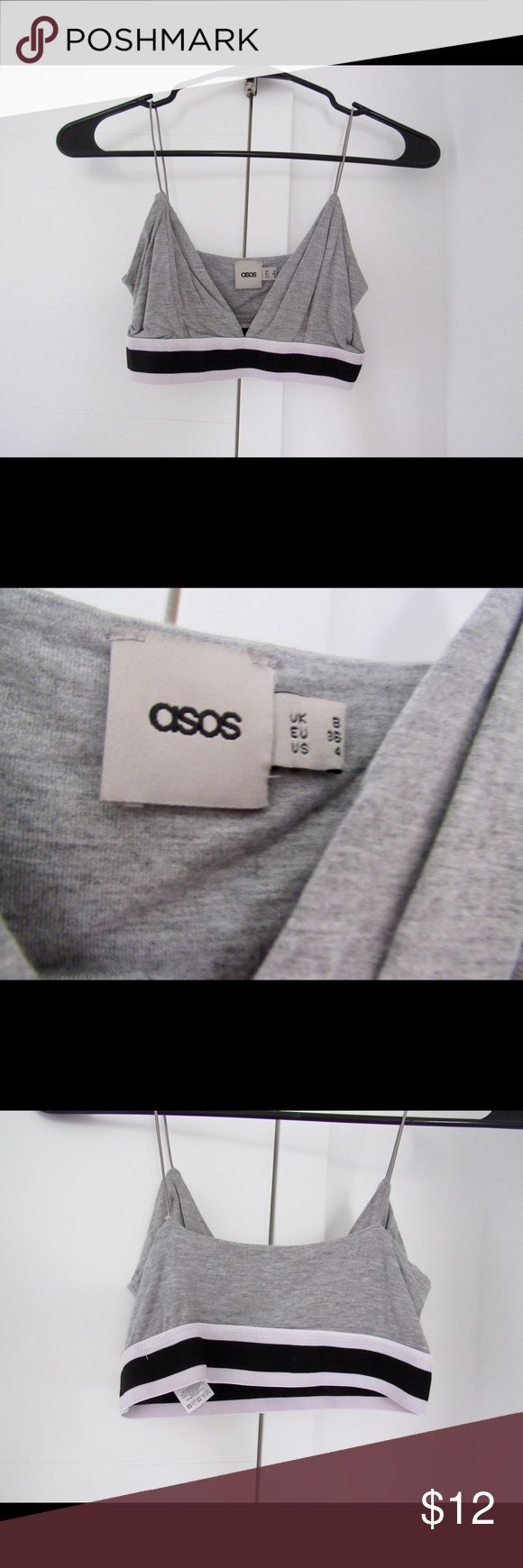 Gray elastic band bralette Elastic band at the bottom of the bralette. Non-adjustable straps. Black and white striped detail. Pair with black high waisted leggings/jeans and black pumps. ASOS Tops Crop Tops