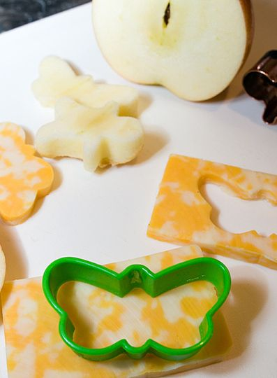 Butterfly cookie cutter cutting out cheese and apple slices!