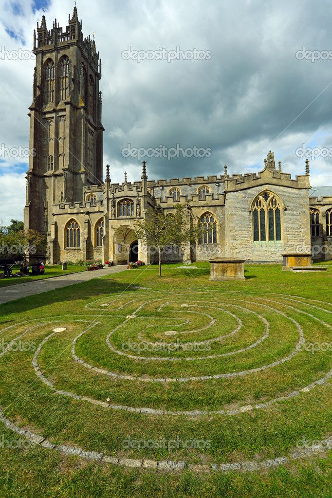 Church of St. John in Glastonbury town, Somerset, England, UK, with the Glastonbury Labyrinth in the foreground.