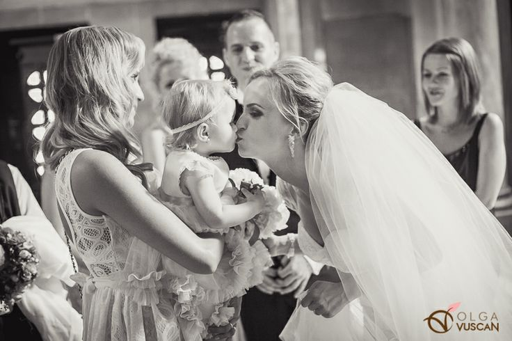 bride kissing her daughter as she arrives at the church_images by Olga Vuscan