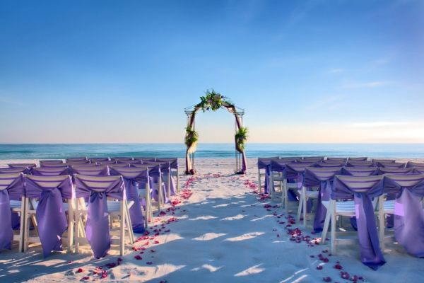 I like the color of the chair accents...that color and a light ocean blue!!! wedding on the beach