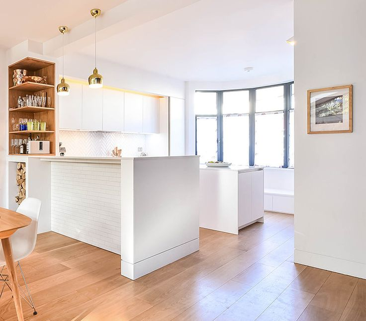 Claudia Urvois Interior Design Kensal Rise Kitchen placed onto the street side of the house. Open corner oak shelving for the bar area with Artek A330S Golden Bell suspensions.