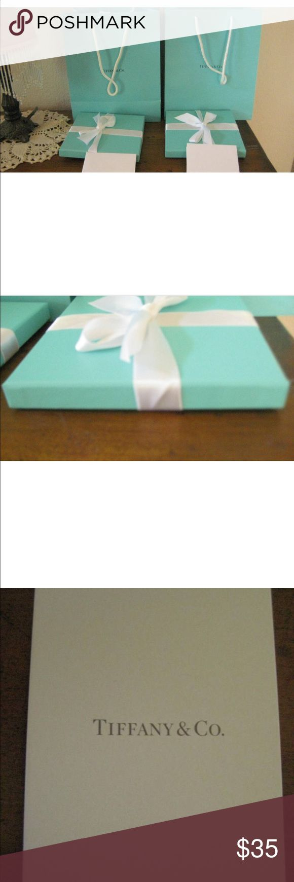 Set of 2 Authentic Tiffany & Co. Sales Packaging This is a set of two Authentic Tiffany and Co. sales bags. They each come with a square tiffany blue box wrapped with white satin ribbon from Tiffany's. They each also come with a small envelope and card inside for you to write whatever you want on it. The card you can write on is embossed with the Tiffany and Co. logo. They are in perfect condition. Tiffany & Co. Other