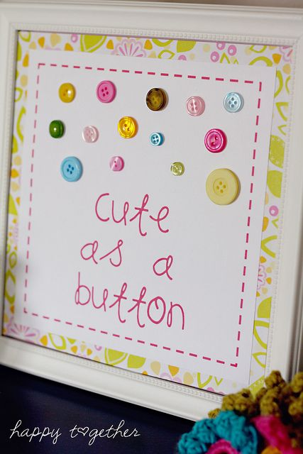 """I agree with the previous comments on having guests glue buttons on something: """"I like the look of this with the idea to build it as part of a baby shower. Have a plainer version and a tin of buttons so guests can each glue buttons to the book cover, then write a welcome message to baby inside. Great keepsake for later."""""""