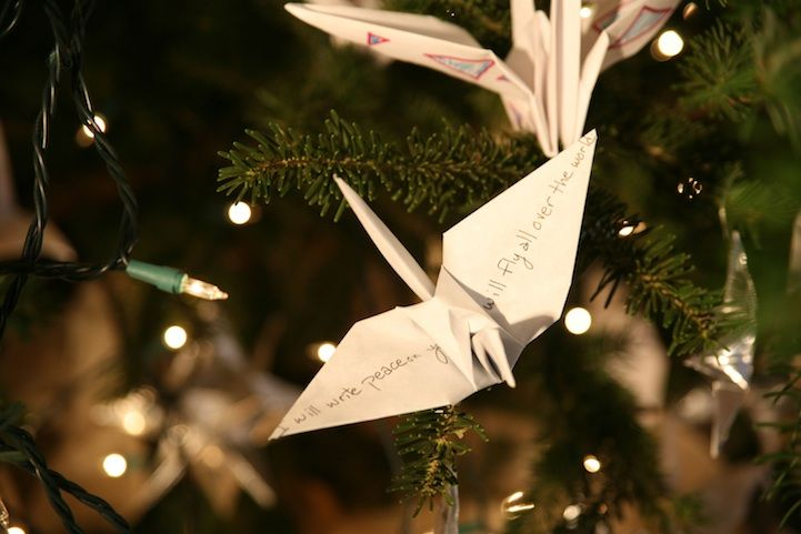Close-up of origami paper cranes on the World Tree of Hope.