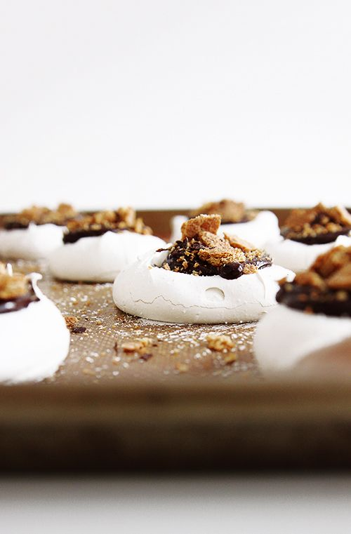 Fancy S'mores—a pavlova (a big cloud of meringue) topped with a two-ingredient ganache and generous dusting of shattered graham crackers.