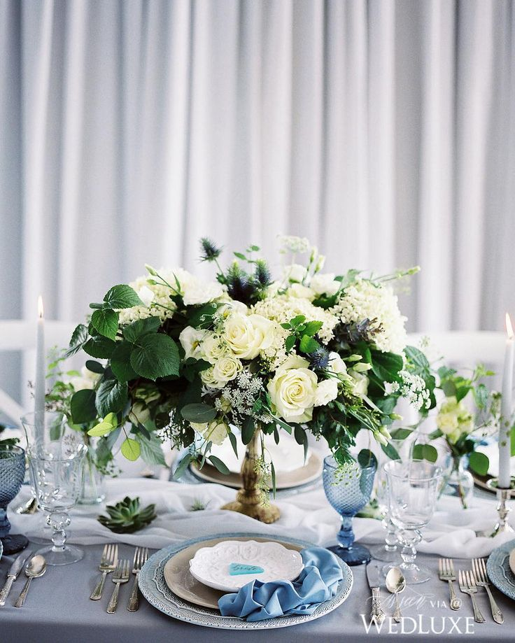 With shades of pale blue and rich, green floral, this #tablescape captures the feeling of a cool, seaside setting! | Photography By: Julia Park Photo | WedLuxe Magazine | #wedding #luxury #weddinginspiration #luxurywedding #floral #floralarrangement #centrepiece #tabledecor #decor