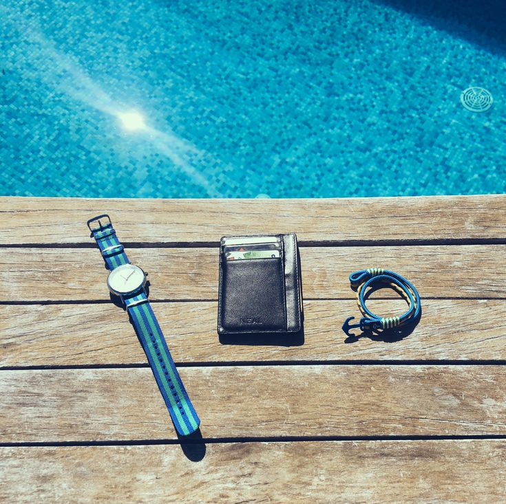 Hit the beach in style with NEAL Slim Wallet!  It fits perfectly with your swimming gear and keeps your essentials in place while you enjoy the sun.  #slimwallet #minimalistwallet #frontpocketwallet #thinwallet #rfid #rfidprotection #wallet #blackwallet #giftsformen #mengifts #giftbox #giftset #travelwallet