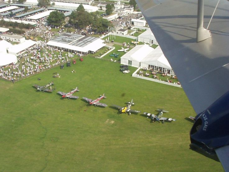 Seeing the warbird lineup at Goodwood Revival from a seat in a Dragon Rapide, 2003