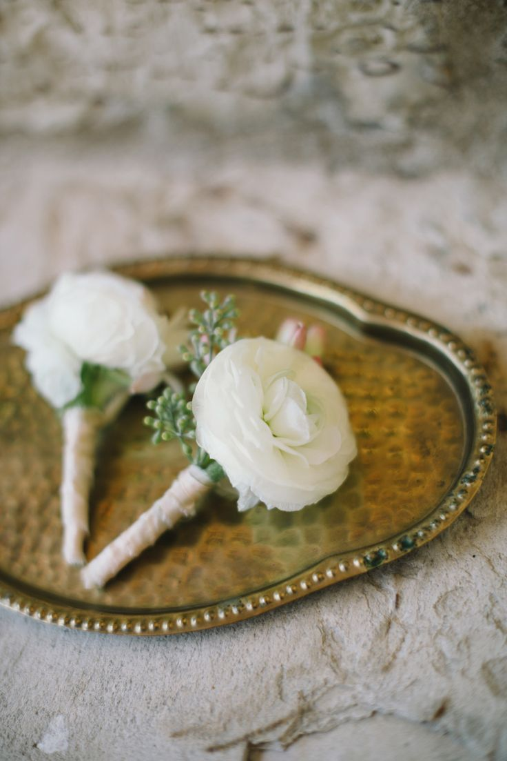 White Ranunculus Boutonniere - Stems Wrapped - Wedding on #smp is here:  StyleMePretty.com/2014/04/17/pastel-colored-holman-ranch-affair/ Photography: DelbarrMoradi.com