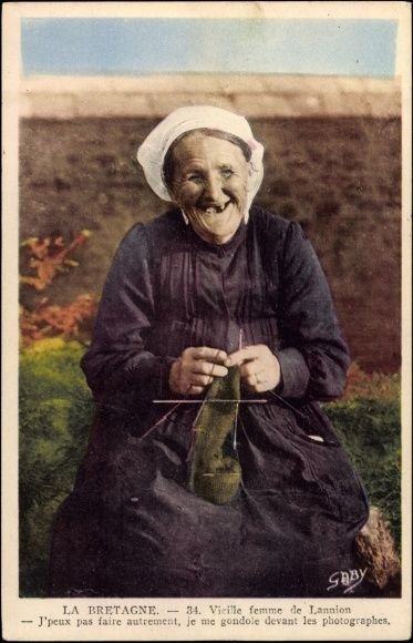 post card of an old French woman knitting. She looks so happy, I love it!