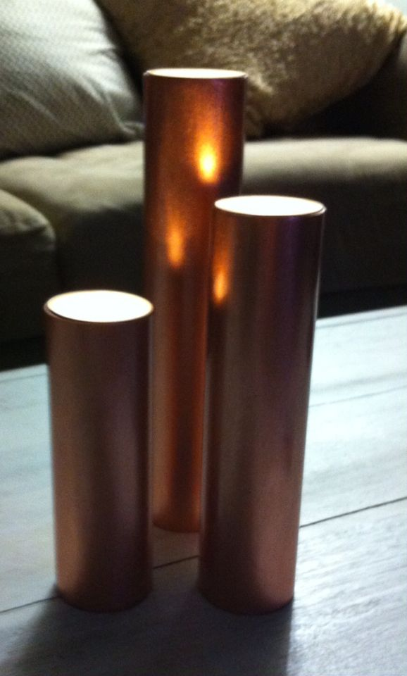 Candles made from recycled copper waste pipe.