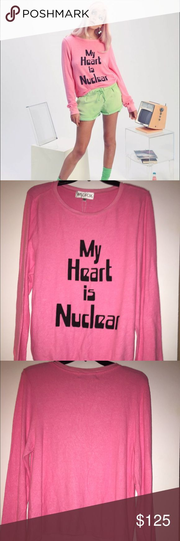🆕 Wildfox 'My Heart is Nuclear' pink BBJ XS & M NWT Wildfox Couture 'My Heart is Nuclear' pink baggy beach jumper sizes XS & M available. From the 2015 Wildfox Girls of Beverly Hills Collection. Please view all photos and ask any questions you may have prior to purchasing. 💗   ❌No Trades❌ Wildfox Tops Sweatshirts & Hoodies