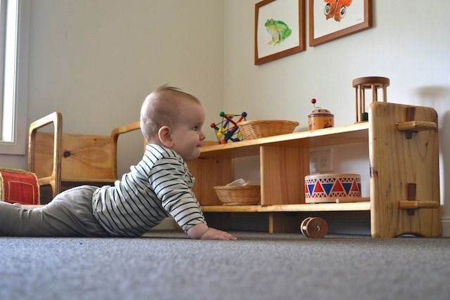 Low shelves (and low art work) are essential in the Montessori infant environment. It gives the infant something to look at, to crawl towards, to aim for.