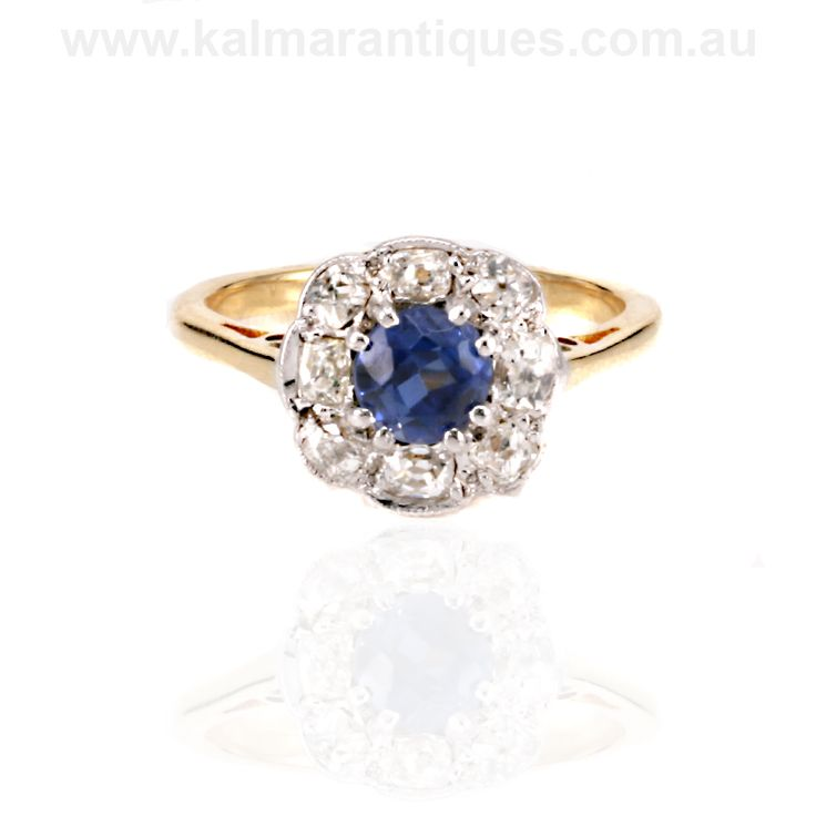 https://www.kalmarantiques.com.au/product/antique-sapphire-and-diamond-ring-4/ | This antique cluster ring from the 1900's has a magnificent Ceylonese sapphire | $5,600
