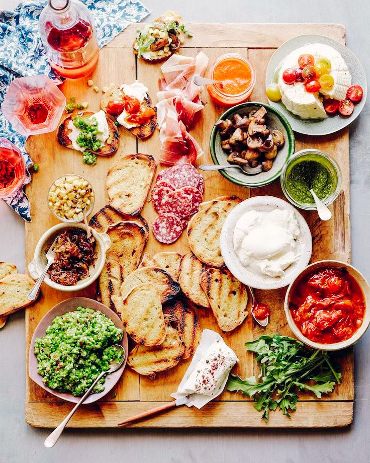 A delicious cheese plate with meats and tomatoes