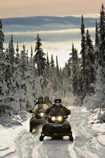 Snowmobiling at Sun Peaks Resort, Canada.