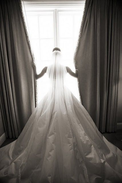 Pose for photo shoot (bride) - to show full train of wedding dress