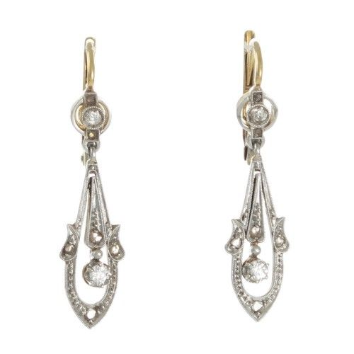 A pair of platinum topped 18ct yellow gold Edwardian plaque earrings made as an open drop shaped frame set with diamonds.