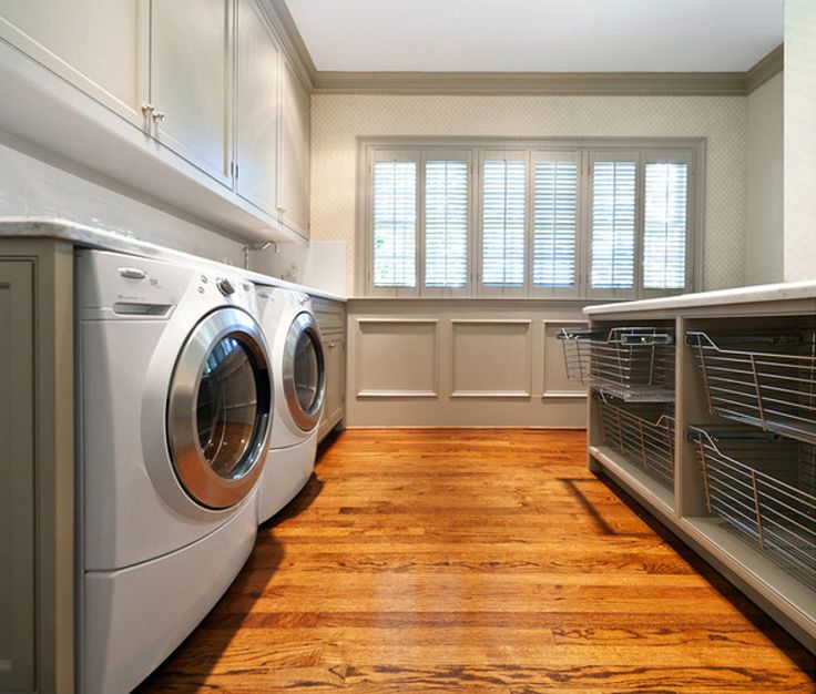 laundry room baskets - four pull out wire laundry baskets in a laundry room island - More Design Build via Atticmag
