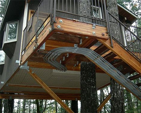 Like many treehouse builders, Charles Greenwood lives in one himself. It gives him a place to tweak and experiment--much like someone would in his garage.    - PopularMechanics.com