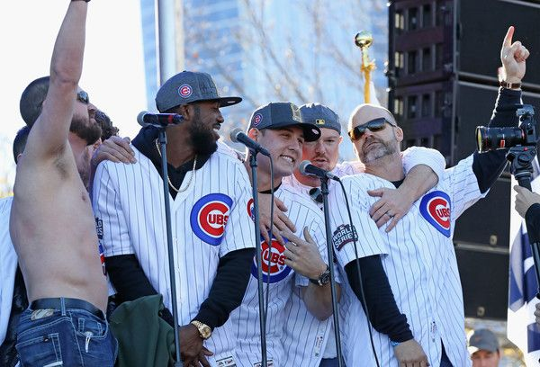 "(L-R) Travis Wood, Dexter Fowler, Anthony Rizzo, Jon Lester and David Ross of the Chicago Cubs sing ""Go, Cubs, Go"" during the Chicago Cubs victory celebration in Grant Park on November 4, 2016 in Chicago, Illinois. The Cubs won their first World Series championship in 108 years after defeating the Cleveland Indians 8-7 in Game 7."