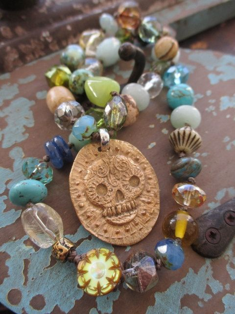 Knotted stones, glass, pearls, and crystals in earthy neutrals. An artisan bronze skull rests front and center.  Measures 18 long. Loop closure with an antique carved snail shell button.  As with all of my jewelry, I ONLY use TOP quality beads in my work. The result is well worth it and it shows! Check out my Facebook page for sneak-peeks of my newest pieces & special deals! www.facebook.com/slashknotsjewelry ORIGINAL LIST DATE: April 12, 2017*Often imitated, never duplicated--You se...