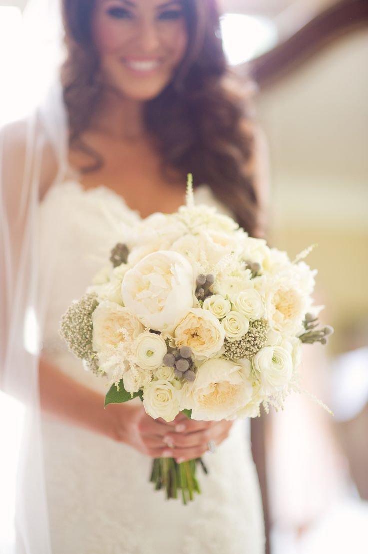 Wedding #Bouquet | #Ivory | Kelly Sweet Photography | #SMP Weddings: http://www.stylemepretty.com/2013/12/04/michigan-backyard-beach-wedding-from-kelly-sweet-photography/