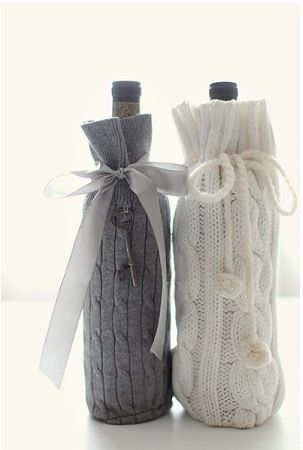 Sweater gift bags for wine bottles. Made out of old sweater sleeves? Will check out website.