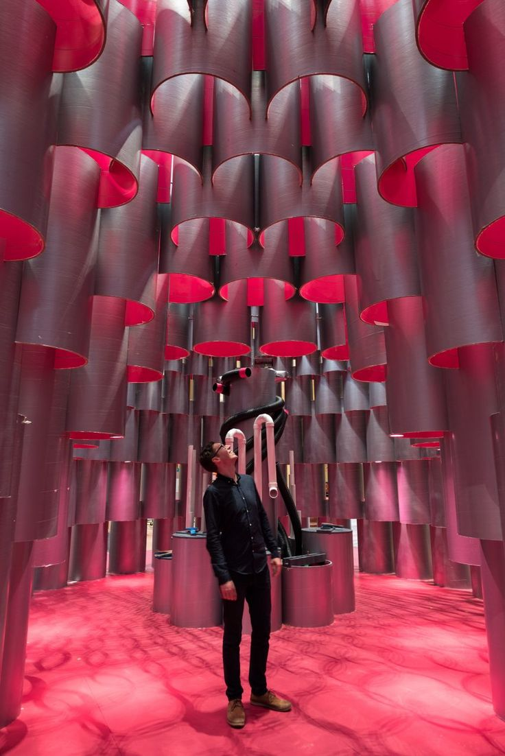 The installation called Hive features over 2,700 tubes of paper in varying sizes, locked together to create pavilion-like temporary structures.