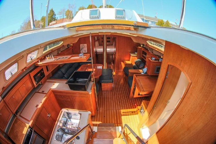 """2001 """"Hunter 460's"""" standard recessed windlass allows the capability of handling two anchors simultaneously on the dual offset anchor roller. The Hunter trademark cockpit arch keeps the adjustable traveler up and out of the way and makes a great attachment point for the Bimini.  See more of her here: http://www.saltsailing.com/2001-hunter-460-salon/"""