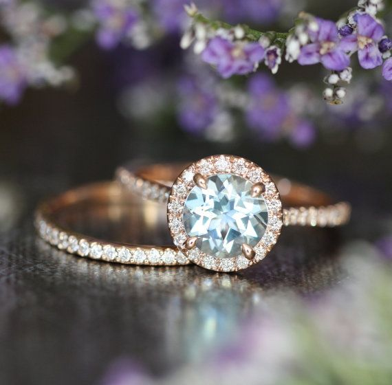 This gemstone wedding ring bridal set showcases an aquamarine engagement ring with a 7x7mm round cut natural aquamarine crafted in a solid 14k rose