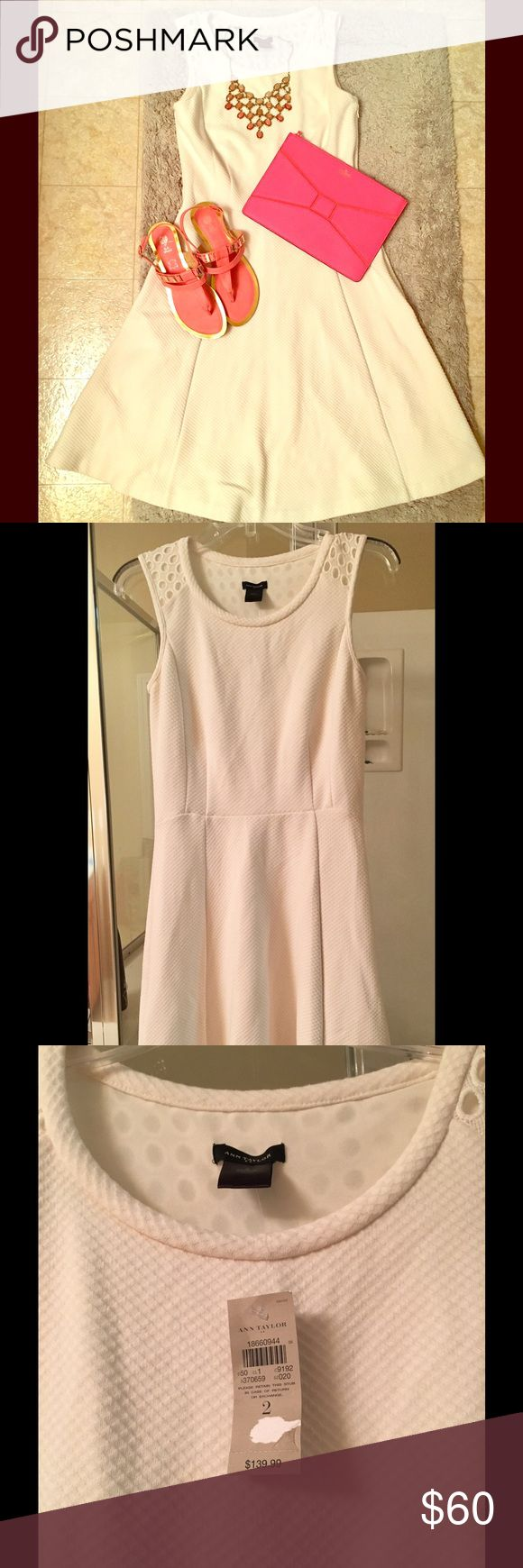"Beautiful sleeveless Ann Taylor sundress Beautifully feminine white sleeveless sundress with eyelet detail on upper back and front shoulders. Thicker material so it is not see through like most white summer dresses can be. Great for and figure, flowy non fitted skirt. Perfect for day or evening and can be paired with cute sandals or a great pair of heels for more sophisticated look. Use pops of color to continually gave a new look. Size zipper for easy on and off. Shoulder to hem 37""…"