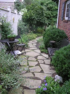 Natural stone path on side of house
