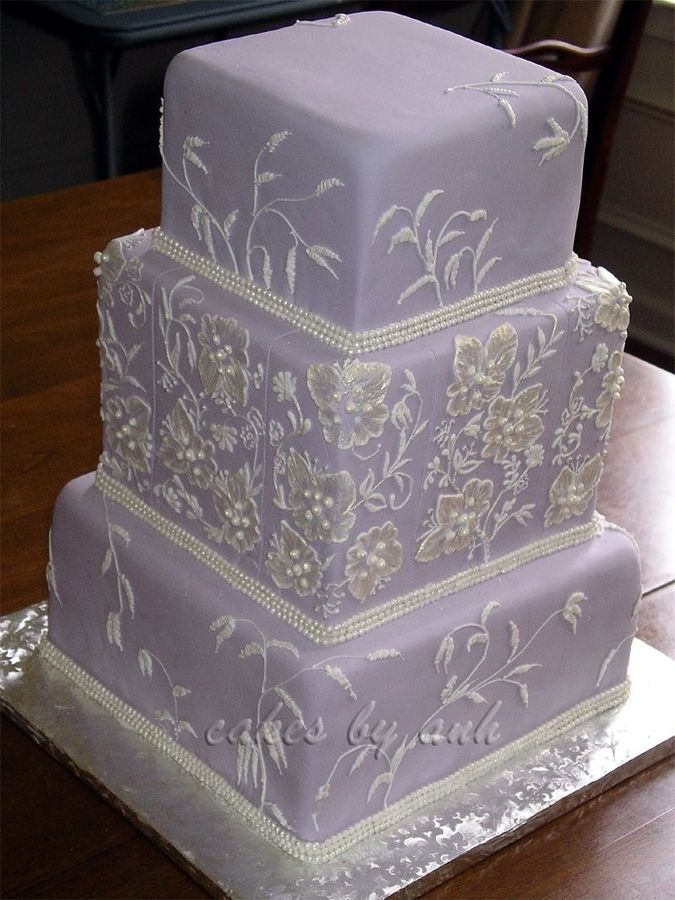 Lavender Embroidery wedding cake ~ This design was inspired by the embroidery on the bride's dress. Edible triple pearl strings border to match her dress as well. I