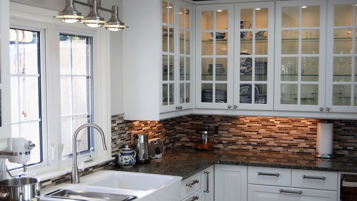 Above-sink lighting? Also, Bodbyn glass doors w/ inside lighting, and gridded cabinets with gridded windows