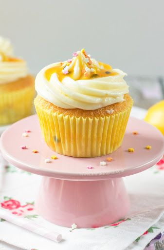 Lemon And Passion Fruit Cupcakes With Margarine, Caster Sugar, Lemon, Large Eggs, Vanilla Extract, Plain Flour, Baking Powder, Milk, Coulis, Unsalted Butter, Powdered Sugar, Lemon, Coulis, Sprinkles