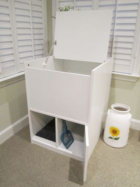 We just bought one outofsightlitterbox.com :: hides and contains cat litter mess and keeps dogs and kids out of litter pan