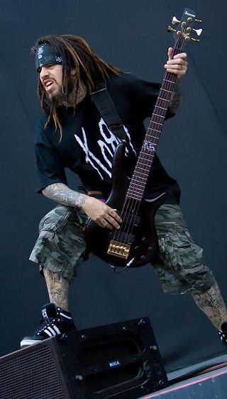 Korn. Love the bass...that's about it...                                                                                                                                                                                 More