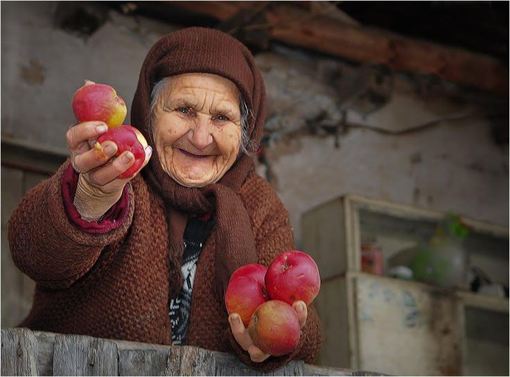 Romanian villager sharing a few apples from her garden