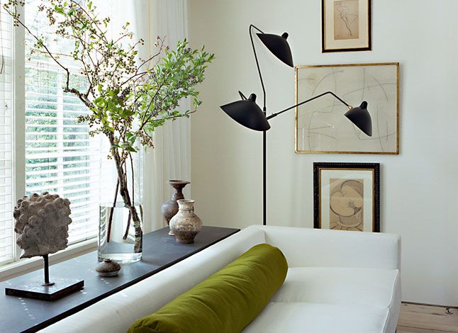 Betsy Brown + One strong color + Serge Mouille lamp.