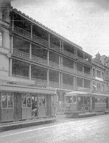 Dymocks Building (The Block) at 424-430 George St,Sydney in 1926.The building was demolished and rebuilt in 1926. Showing two trams,the second tram Leichhardt bound. •City of Sydney Archives•