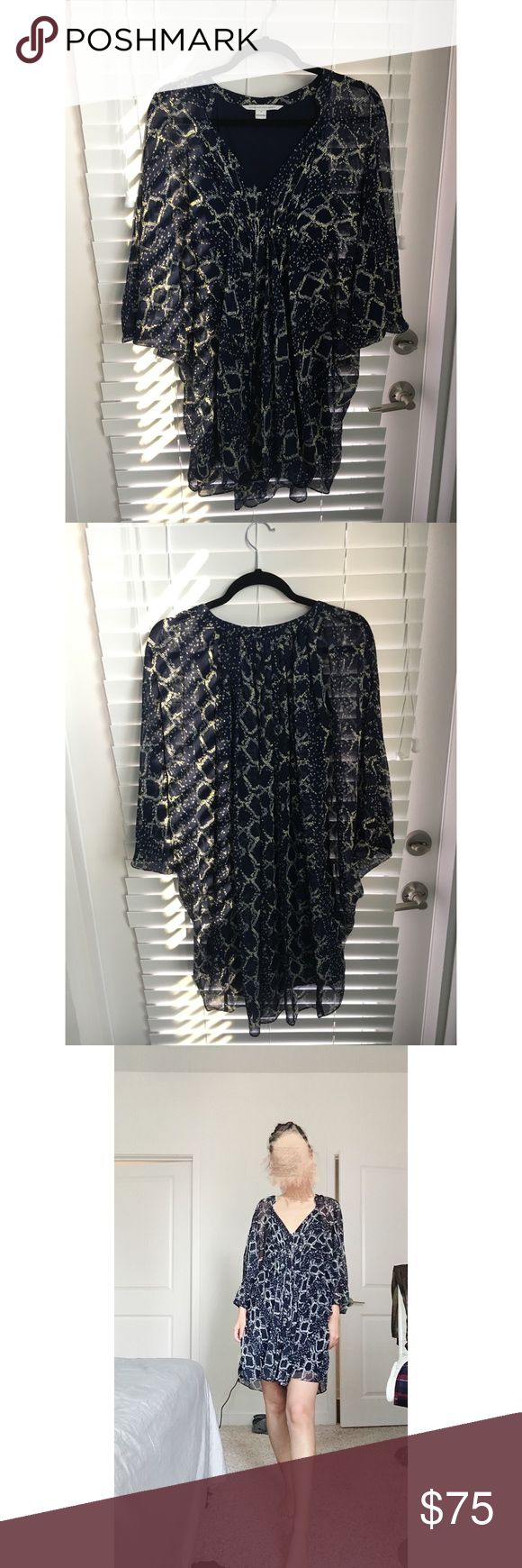 Diane Von Furstenberg silk dress Size 0. Would fits anyone XS, S. Silk lining. Navy blue with yellow/cream print. Perfect for vacation as beach dress or even bikini cover! Never worn. I'm 5'6, 105lbs with small upper body and bigger hip. For your reference, I have plenty space left upper body and some space left around hips trying on this dress. Diane Von Furstenberg Dresses