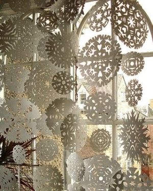 Paper snow flakes in the window