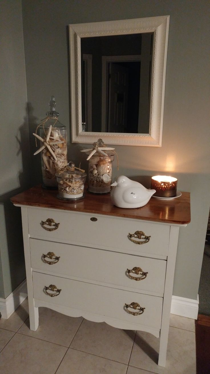 Simple antique dresser painted with milk paint. Top finished with Puritan Pine stain and Minwax polyurethane finish. Perfect little hallway piece.