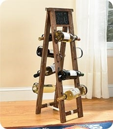 ladder turned wine rack with a chalkboard, i think i might pull apart and attach to wall? thinking...