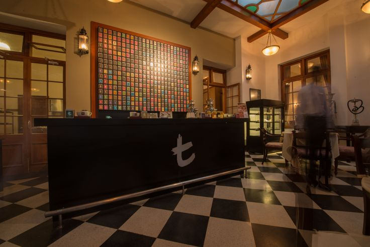 The Grand Hotel celebrates the industry of tea - the afternoon tea brasserie.  Behind the serving bar are boxes and boxes of tea - notice the heart!
