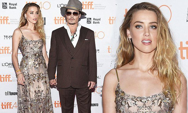 Amber Heard, 29, unites with husband Johnny Depp, 52, at TIFF