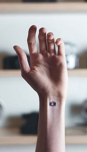 This camera tattoo is always picturesque.